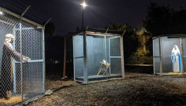 jesus, joseph, and the virgin mary in separate cages