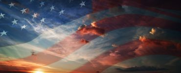 an american flag superimposed over the setting sun in a rural area